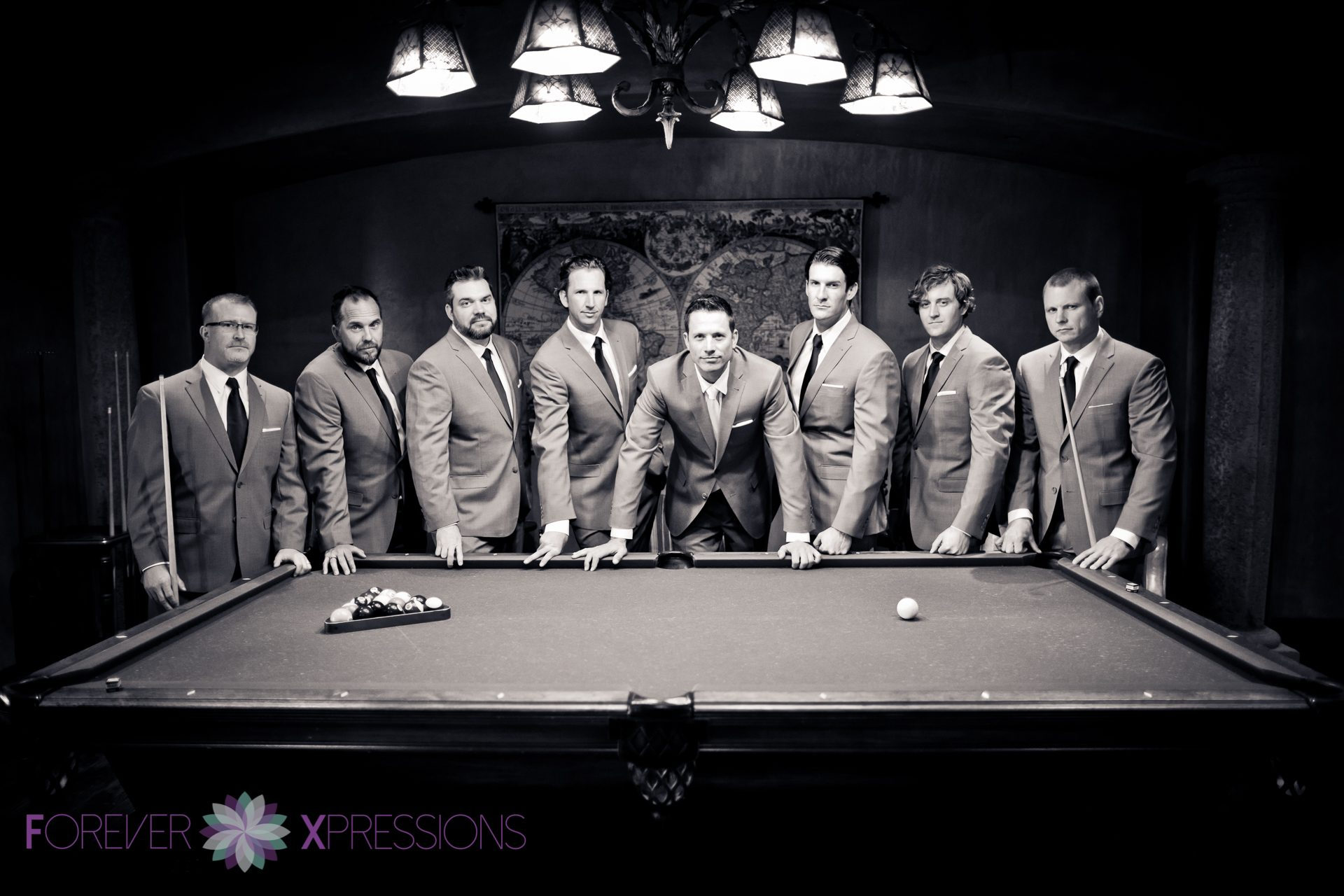 Groomsmen portrait by pool table at Bella Collina.